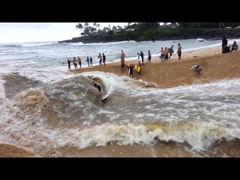 Surfer Rides The River Waves