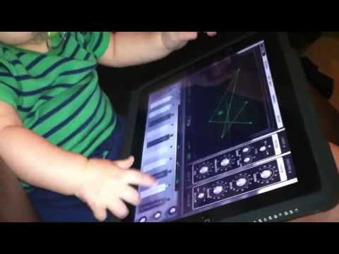 Cute - Baby Boy Plays With iPad