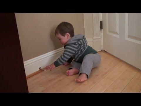 Babies Playing With Door Stoppers