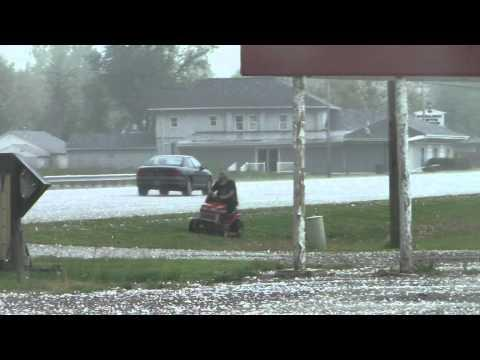 Crazy - Guy Mows His Lawn During Hail Storm