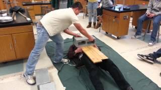 Physics Teacher Gets Hit With Sledge Hammer Experiment