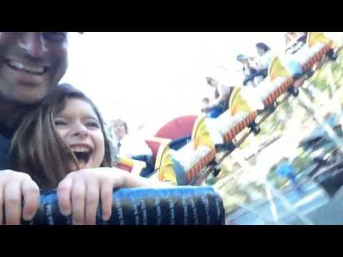 Little Girl's First Roller Coaster Ride