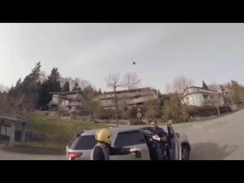 Crazy Vancouver Police Officer Runs Longboarders Off The Road