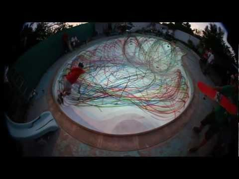 Creative - Pool Artwork Painted Using A Skateboard And A Spray Can