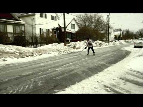 Canadian Plays Ice Hockey On The Frozen Road