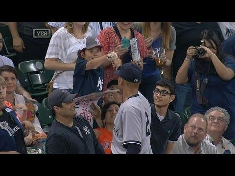 Woman Tries to Steal The Ball From Derek Jeter